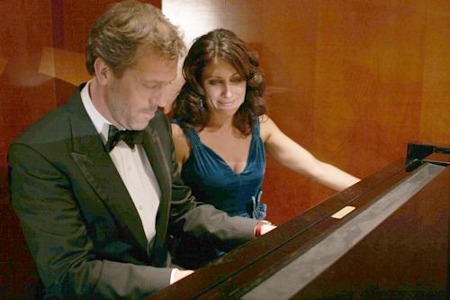 "In this image released by Fox, Hugh Laurie, left, and Lisa Edelstein are shown in a scene from ""House, M.D."" The Fox medical drama concludes its eight-season run on Monday, May 21, 2012, with a finale at 9 p.m. EDT, preceded by a one-hour retrospective.(AP Photo/Fox, Isabella Vosmikova)"