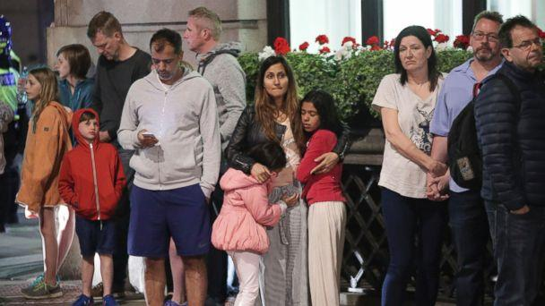 PHOTO: Guests from the Premier Inn Bankside Hotel are evacuated and kept in a group with police on Upper Thames Street following an incident in central London, June 3, 2017. (Yui Mok/PA via AP)