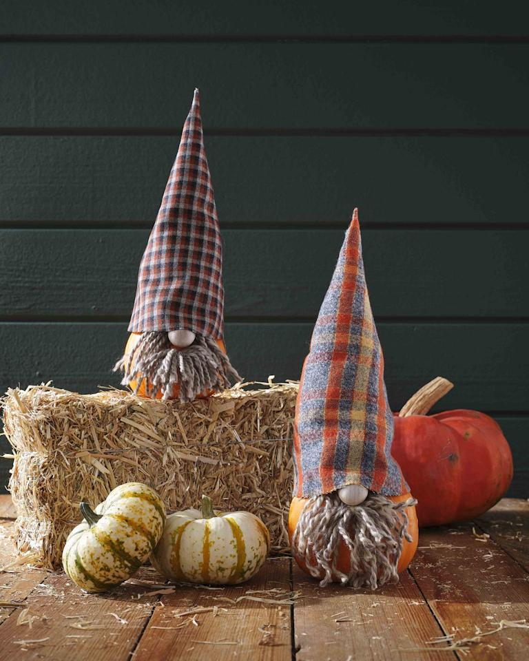 """<p>Keep those garden gnomes company with these warm and fuzzy pumpkin friends.</p><p><strong>Make the pumpkin:</strong> Trace hat <a href=""""https://hmg-prod.s3.amazonaws.com/files/gnomehat-1592336643.pdf"""" target=""""_blank"""">template</a> on wool fabric, adjusting size as necessary; cut out. Use craft glue or iron-on fusible tape to glue straight edges together. Fill hat with batting to help it stand upright; set on pumpkin. Attach a small wood craft bead to a small pumpkin with hot-glue to create a nose. Attach strands of yarn with hot glue around nose to create beard; trim as necessary.</p><p><a class=""""body-btn-link"""" href=""""https://www.amazon.com/dp/B084ZZCQ16/ref=twister_B08B742SY9?tag=syn-yahoo-20&ascsubtag=%5Bartid%7C10050.g.28437255%5Bsrc%7Cyahoo-us"""" target=""""_blank"""">SHOP FABRIC</a></p>"""