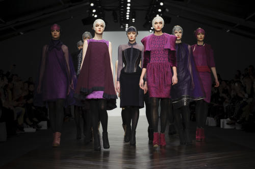 Models wear designs from the Bora Aksu collection during London Fashion Week, Friday, Feb. 15, 2013, in London. (Photo by Jonathan Short/Invision/AP)