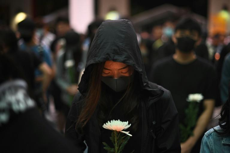 There were tearful vigils to mourn the death of a student who died during clashes with police in Hong Kong