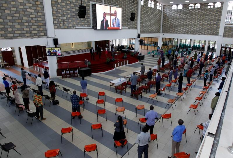 Faithful sing a hymn during a church service amid concerns about the spread of coronavirus disease (COVID-19) at the African Inland Church (AIC) Milimani in Nairobi
