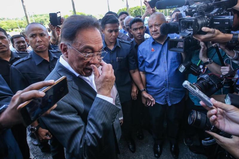 PKR President Datuk Seri Anwar Ibrahim arrives at the PKR headquarters in Petaling Jaya, February 23, 2020. — Picture by Hari Anggara