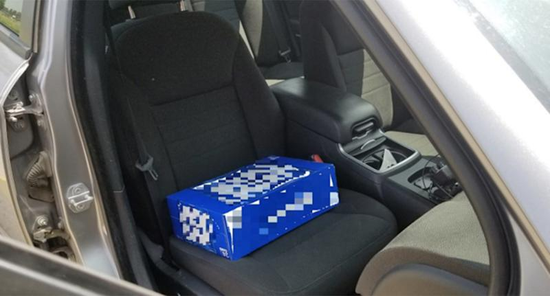 Father uses case of beer as booster seat for child, police say
