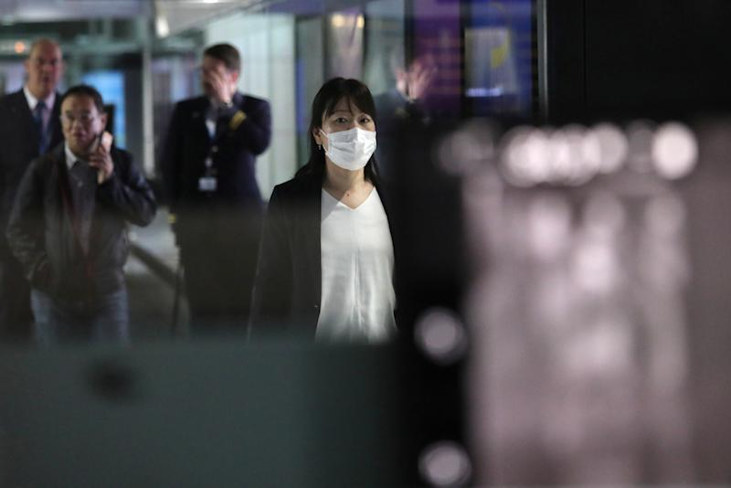 A woman with a mask passes by a thermal screening point at the international arrival terminal of Kuala Lumpur International Airport in Sepang January 21, 2020. — Reuters pic