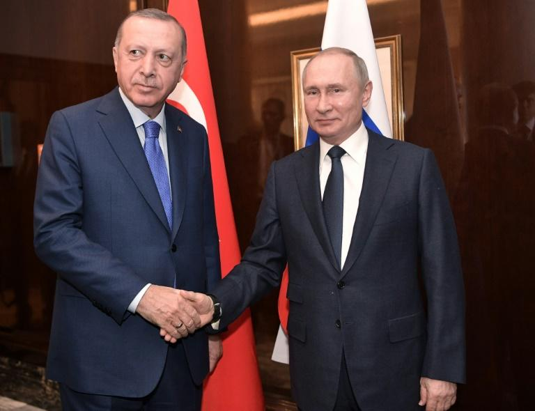 """The Turkish foreign minister said that President Recep Tayyip Erdogan (L, pictured January 2020) and Russian President Vladimir Putin """"have agreed to come together at a bilateral meeting"""""""
