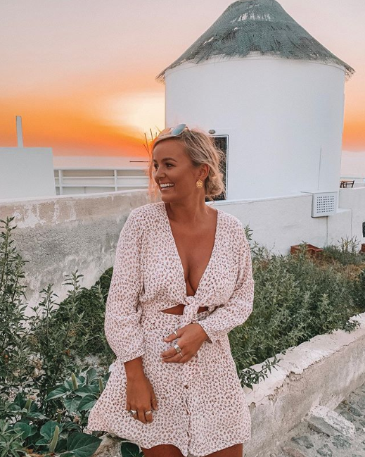 A photo of eliminated Bachelor Australia star Elly Miles wearing a white dress while on holiday in Europe.