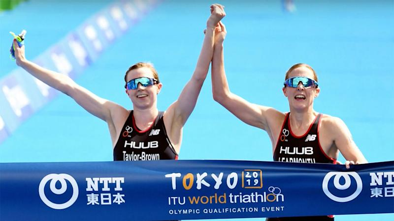 The British triathlon winners were disqualified for crossing the finish line holding hands.