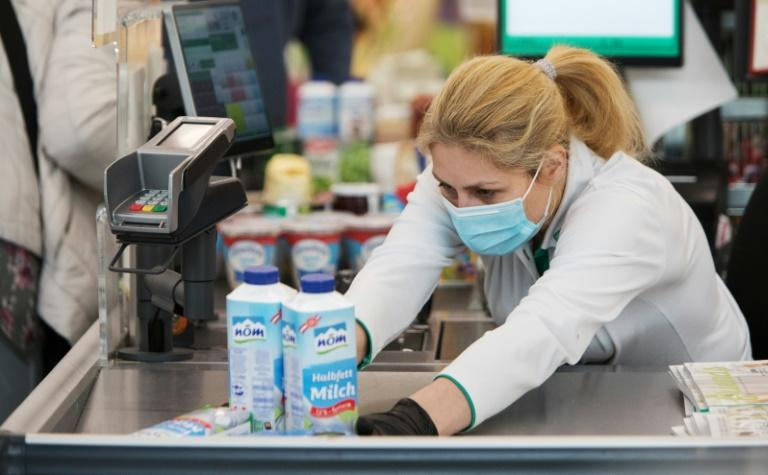 """Despite suggestions in some quarters that wearing a mask in public once might have suggested """"hypochondria"""" Austrians are now having to get used to donning one to go to the supermarket as the government seeks to stop the spread of the new coronavirus"""