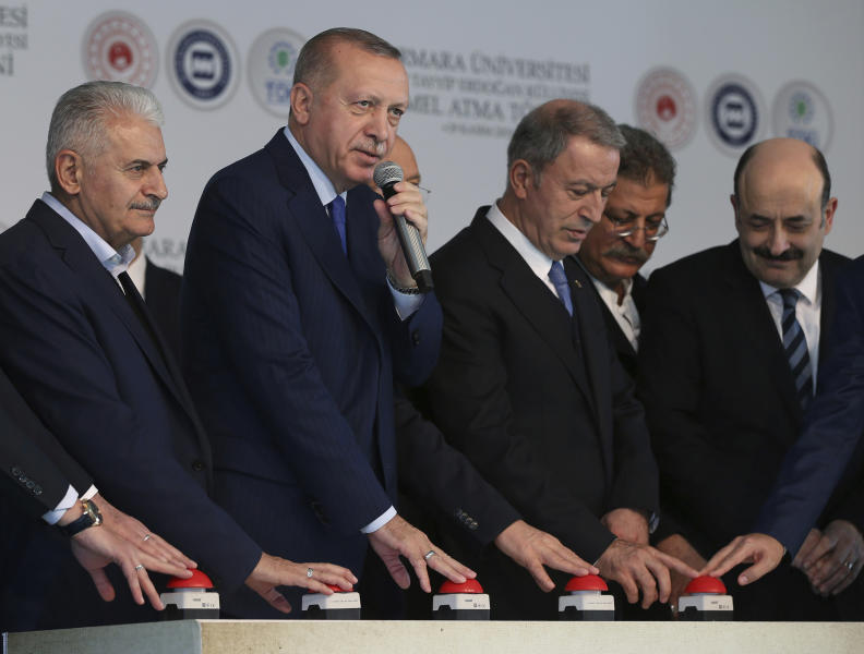 "Turkey's President Recep Tayyip Erdogan, second left, speaks during the ground-breaking of Marmara University's Recep Tayyip Erdogan complex, in Istanbul, Friday, Nov. 29, 2019. Erdogan slammed French President Emmanuel Macron Friday for his comments on NATO and Turkey's membership. ""You should get checked whether you're brain-dead,"" Erdogan called out to Macron.( Presidential Press Service via AP, Pool ) ."