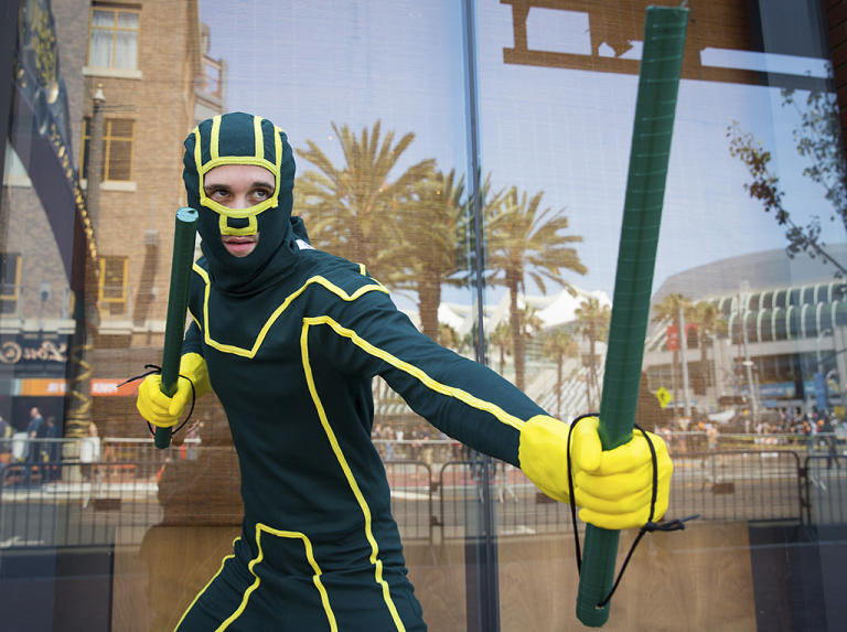 Cosplayer Travis Stapleton poses while dressed as comic book character Kick-Ass during the 2013 San Diego Comic-Con (SDCC) International