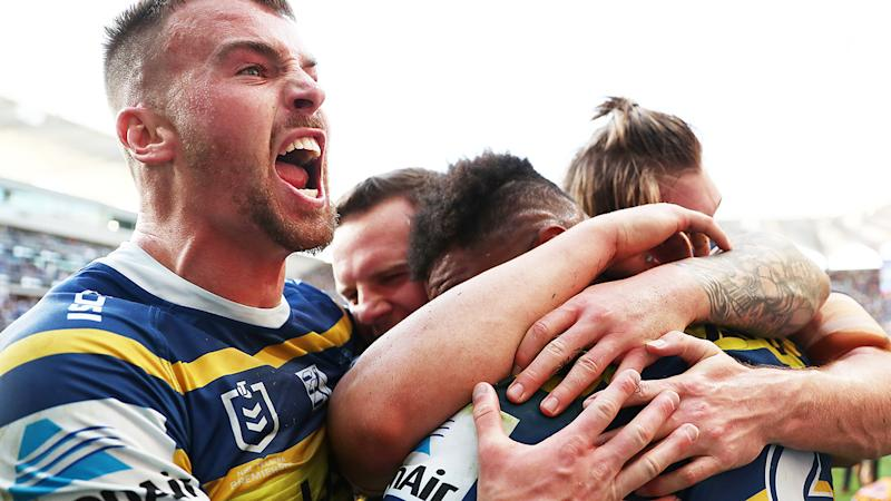 The Parramatta Eels, pictured celebrating a try, gave the Brisbane Broncos a historic thumping in their NRL elimination final.