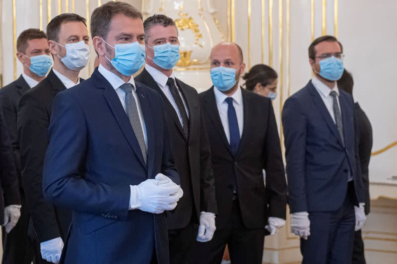 FILE PHOTO: Slovakia's Prime Minister Igor Matovic and members of his cabinet wearing protective face masks attend the cabinet's inauguration at Presidential Palace in Bratislava