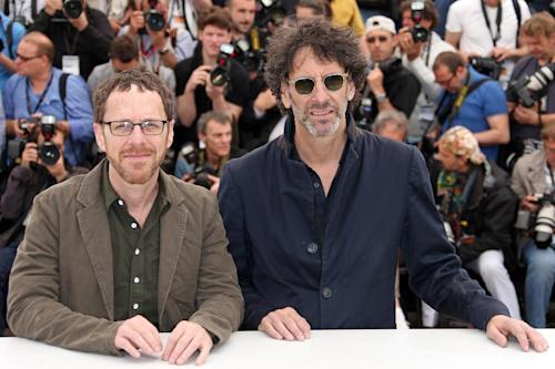 Directors Ethan Coen, left, and Joel Coen pose for photographers during a photo call for the film Inside Llewyn Davis at the 66th international film festival, in Cannes, southern France, Sunday, May 19, 2013. (Photo by Joel Ryan/Invision/AP)