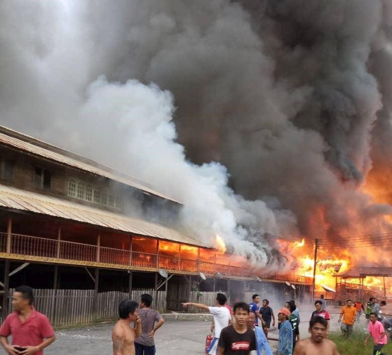 Two blocks of the Uma Bawang longhouse were destroyed in a fire this evening. — Picture courtesy of the state Fire Dept
