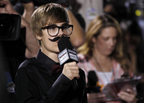 "FILE - In this Friday, Jan. 14, 2011 file photo, Justin Beiber is seen interviewing on the red carpet at the 16th Annual Critics' Choice Movie Awards in Los Angeles. Dubai newspapers quote a police official Tuesday, May 7, 2013 saying the megastar racked up a ""number"" of speeding fines before being pulled over. The official was not named and no other details were given. The Dubai police media office referred to the newspaper reports when asked for comment. (AP Photo/Matt Sayles, File)"