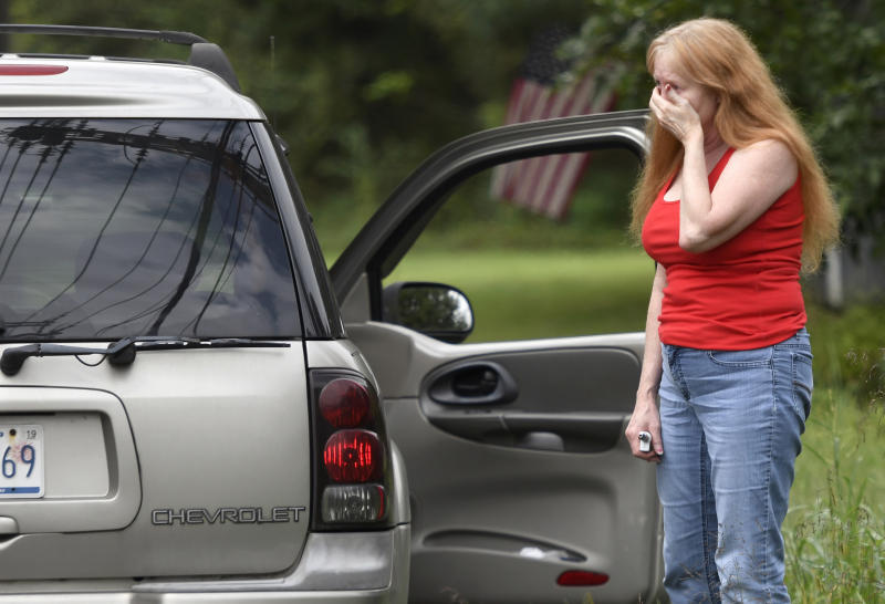 Maryland shooting: A family member of a man working in the building reacts to the news. Source: AP