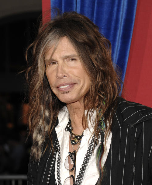 "FILE - This March 11, 2013 file photo shows singer Steven Tyler arriving at the world premiere of the feature film ""The Incredible Burt Wonderstone"" in Los Angeles. The future is looking bleak for the Hawaii celebrity privacy bill known as the Steven Tyler Act. The proposal pushed by the Aerosmith lead singer is missing deadlines in the state House and key lawmakers say they won't push it through. The bill to prevent unwanted photos and video people in their private moments sailed through the state Senate earlier this month, after Tyler testified in person at a committee hearing in February. (Photo by Dan Steinberg/Invision/AP, file)"