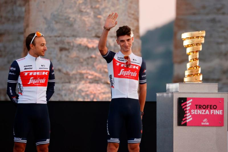 Team Trek rider Italys Giulio Ciccone C waves on stage at the Doric Temple of Segesta near Palermo Sicily on October 1 2020 during an opening ceremony of presentation of participating teams and riders two days ahead of the departure of the Giro dItalia 2020 cycling race Photo by Luca Bettini AFP Photo by LUCA BETTINIAFP via Getty Images