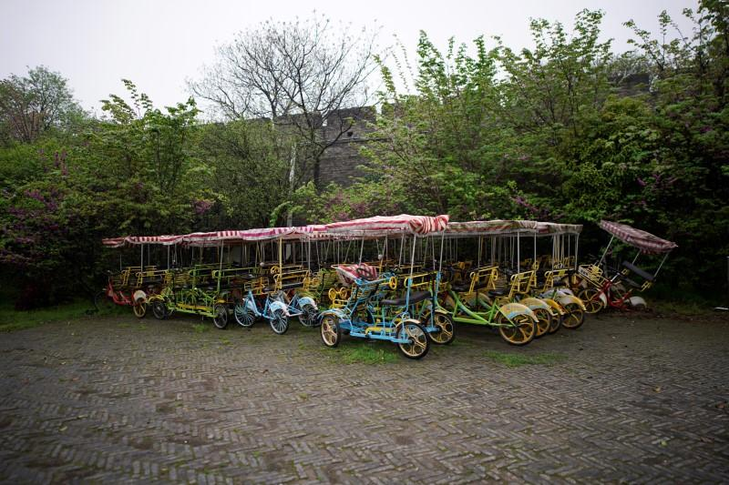 Vehicles for tourists are seen parked at an ancient city wall in Jingzhou, after the lockdown was eased in Hubei