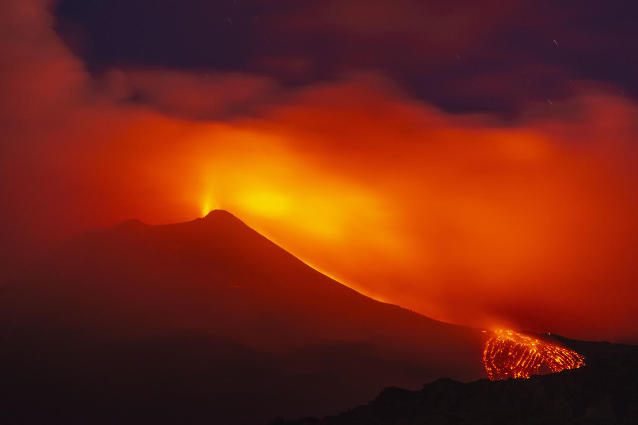 <p>Mount Etna in Sicily spews lava during an eruption early Saturday. The volcano has roared back into spectacular explosive action, sending up plumes of ash and spewing lava. (AP Images) </p>