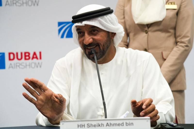 FILE - In this Nov. 20, 2019, file photo, Sheikh Ahmed bin Saeed Al Maktoum, the chairman and CEO of the Dubai-based long-haul carrier Emirates, gives a news conference at the Dubai Airshow in Dubai, United Arab Emirates. On Sunday, March 22, 2020, Sheikh Ahmed announced that the long-haul carrier Emirates would suspend all passenger flights beginning Wednesday, March 25, 2020, over the effects of the global coronavirus pandemic. (AP Photo/Jon Gambrell, File)