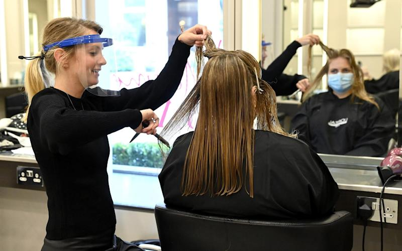 A client gets her hair coloured at the Jo Hansford salon in Mayfair on July 04, 2020 in London, England. - Karwai Tang/Getty Images Europe