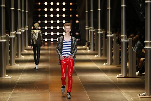 A model presents a creation as part of Yves Saint Laurent men's fashion Spring-Summer 2014 collection, presented Sunday, June 30, 2013 in Paris. (AP Photo/Francois Mori)