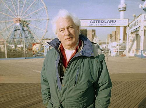 "FILE - This Jan. 26, 1998 file photo shows author Joseph Heller along the Coney Island boardwalk in the Brooklyn borough of New York. Heller's short story, ""Almost Like Christmas,"" will appear next week in Strand Magazine. It is a about the stabbing of a Southern white, the town's thirst for revenge and the black man who has resigned himself to blame. Written in the late 1940s or early '50s, after Heller had returned from World War II, the story has rarely been seen and offers a peak at the early fiction of one of the 20th century's most famous writers. (AP Photo/Todd Plitt, File)"
