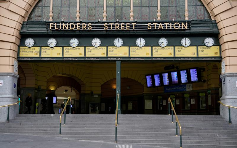Normally buzzing, Flinders Street train station in the city centre is practically empty after lockdown restrictions were implemented in Melbourne - REUTERS/Sandra Sanders