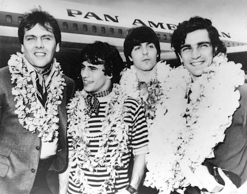 "FILE - This Feb. 26, 1968 file image shows, from left, Gene Cornish, Eddie Brigati, Dino Danelli and Felix Cavaliere from the American rock group The Rascals at JFK Airport in New York, after a trip to Hawaii. The group, gave us ""Good Lovin,'"" ""People Got To Be Free"" and ""I've Been Lonely Too Long"" are grooving their way to Broadway. Performances of ""The Rascals: Once Upon a Dream"" will begin April 15 at the Richard Rodgers Theatre for 15 shows, ending May 5. (AP Photo, file)"