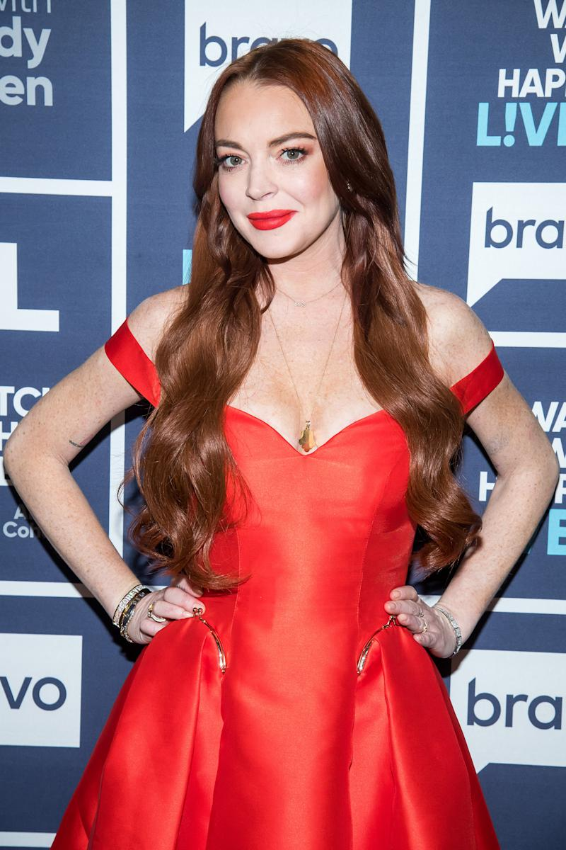 Lindsay lohan poses in a red dress on the red carpet WATCH WHAT HAPPENS LIVE WITH ANDY COHEN