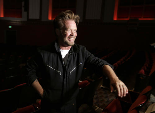 "This Tuesday, Oct. 8, 2013 photo shows musician John Mellencamp after a press preview of the musical ""Ghost Brothers of Darkland County"" at the Indiana University Auditorium in Bloomington, Ind. The musical by Mellencamp, writer Stephen King and T Bone Burnett will debut in Bloomington on Thursday before embarking on a tour of 20 U.S. cities. (AP Photo/Michael Conroy)"