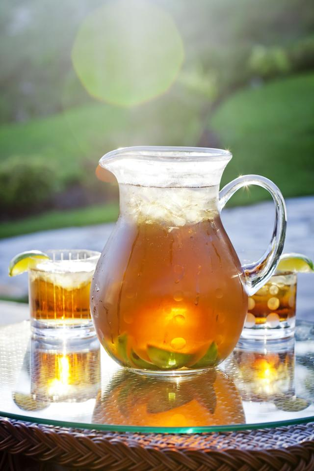 """<p>Few things say summer like a big ol' pitcher of an <a href=""""https://www.goodhousekeeping.com/institute/a24719/7-easy-iced-tea-cocktails/"""" target=""""_blank"""">iced tea cocktail</a> on the buffet at a backyard barbecue. It's a win-win, really — the refreshing treat is more inspired than an array of sodas, <a href=""""https://www.goodhousekeeping.com/health/diet-nutrition/a19875/homemade-iced-tea-benefits/"""" target=""""_blank"""">bottled tea</a>, and water, but there's no need to break a sweat when brewing. With the right iced tea maker at your disposal, whipping up a big batch of tea is as easy as 1-2-3.  </p><p>""""Iced tea makers work similarly to coffee makers,"""" says Nicole Papantoniou, senior testing editor in the <a href=""""https://www.goodhousekeeping.com/institute/about-the-institute/a19748212/good-housekeeping-institute-product-reviews/"""" target=""""_blank"""">Good Housekeeping Institute</a> Kitchen Appliances and Technologies Lab. """"Add tea (loose or in the bag) to the basket and allow hot water to dispense over it and brew into a pitcher filled with ice."""" Alternatively, iced tea can also be made like cold brew — steeped in cold water for a long period of time. """"The benefit of an iced tea maker is being able to make any type you'd like without worrying about added sweeteners, additives, and preservatives,"""" Papantoniou explains. </p><p>When shopping for iced tea makers, you have your fair share of choices — namely, electric or non-electric. But not all models function the same way: </p><ul><li><strong>Some electric machines </strong>allow you to brew tea directly over ice, while others require you to brew tea in the kettle and then pour over ice. Though bulkier, electric machines make prep a breeze. </li><li><strong>Manual, or non-electric, models</strong> operate just like cold brew machines (and are, in fact, interchangeable), requiring hours to adequately steep. These options are more compact and portable, but require much more forethought and patience.</li></ul><p>Which type of i"""