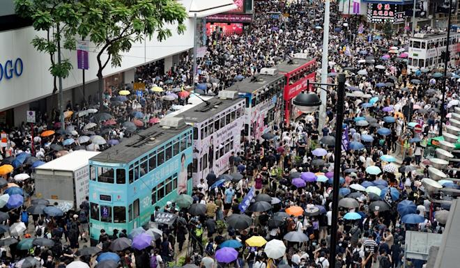 Crowds gather in Causeway Bay to protest against the proposed national security law. Photo: Robert Ng