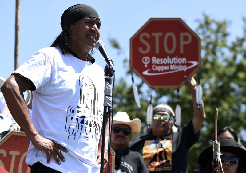 FILE - In this July 22, 2015 file photo, Tribal councilman Wendsler Nosie Sr. speaks with Apache activists in a rally to save Oak Flat, land near Superior, Ariz., sacred to Western Apache tribes, in front of the U.S. Capitol in Washington. Nosie is drawn to a mountainous area in central Arizona where he and other Apaches have harvested medicinal plants, held coming-of-age ceremonies and gathered acorns for generations. On Thursday, Nov. 28, 2019, he'll start a three-day journey to make a permanent home at Chi'chil Bildagoteel, or Oak Flat, in protest of a copper mine made possible by a federal land exchange. (AP Photo/Molly Riley, File)