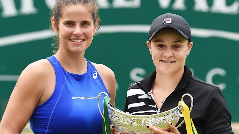 Ashleigh Barty (R) and runner-up Julia Gorges (L). (Photo by PAUL ELLIS/AFP/Getty Images)