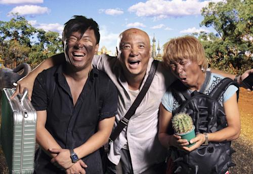"""In this publicity image released by Pegasus Motion Pictures, """"Lost in Thailand"""" stars, from left, Bo Huang, Xu Zheng, and Wang Baoqiang, pose together. Xu, the director, writer and star of China's biggest box-office hit, says """"Lost in Thailand"""" succeeded by showing a rarely seen subject: modern Chinese life. The historical epic, fantasy, action and thriller genres have long filled China's domestic movie screens. But """"Lost in Thailand"""" was a low-budget and light-hearted road-trip tale about an ambitious executive who goes to Thailand to get his boss's approval for a business deal. Along the way he's pursued by a rival co-worker and encounters a wacky tourist who helps him rethink his priorities. (AP Photo/Pegasus Motion Pictures)"""