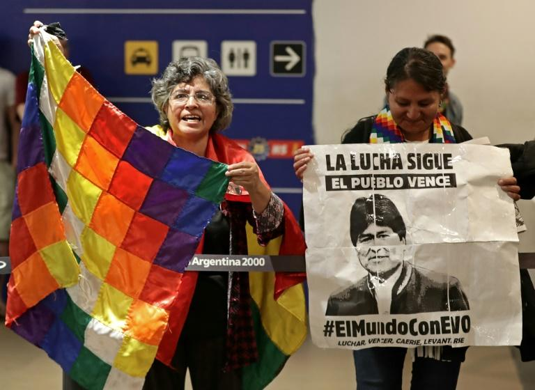 Bolivian citizens living in Argentina wait at the Buenos Aires airport for the arrival of former Bolivian president Evo Morales's children Evaliz and Alvaro