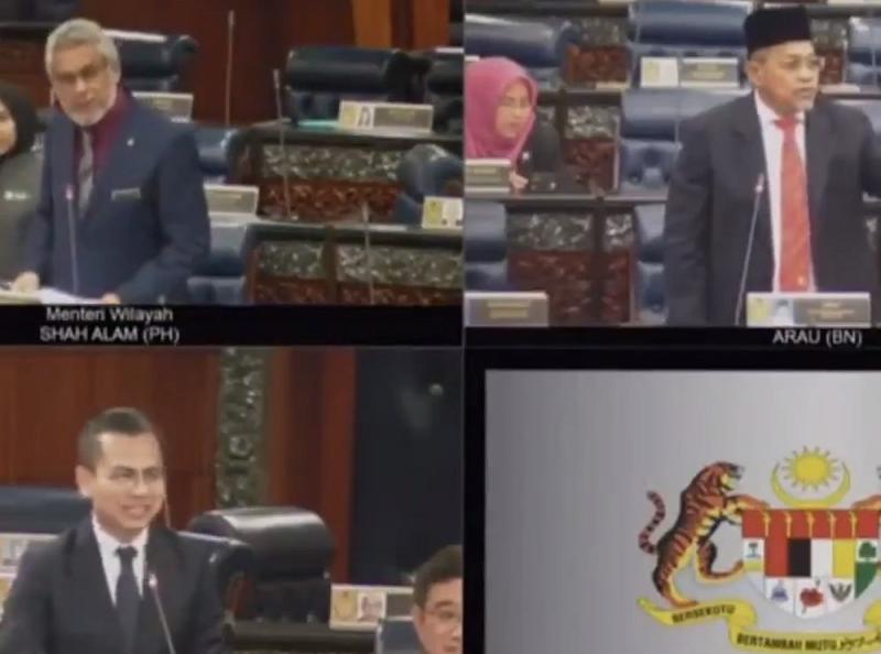 Members of Parliament smile when Arau MP Datuk Seri Shahidan Kassim informs that Malaysia has taken the lead against Indonesia. — Screengrab via Twitter/@HafizRayyan