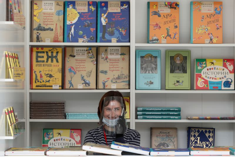 An assistant works at the annual Red Square Book Fair in central Moscow