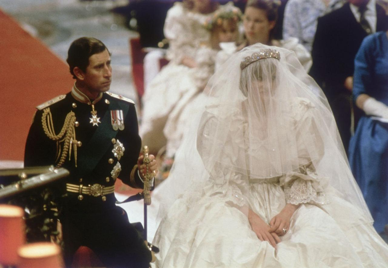 """<p>On the day of her wedding, Princess Diana reportedly spilled some Quelques Fleurs perfume on her dress, which left her with a small stain. Her makeup artist Barbara Daly recounted the incident in her book <a href=""""https://books.google.com/books?id=pa31lwPwTI4C&pg=PA25#v=onepage&q&f=false"""" target=""""_blank""""><em>Diana: The Portrait</em></a>. As a solve, Diana tucked the front of her dress in, though, hiding the stain.</p>"""