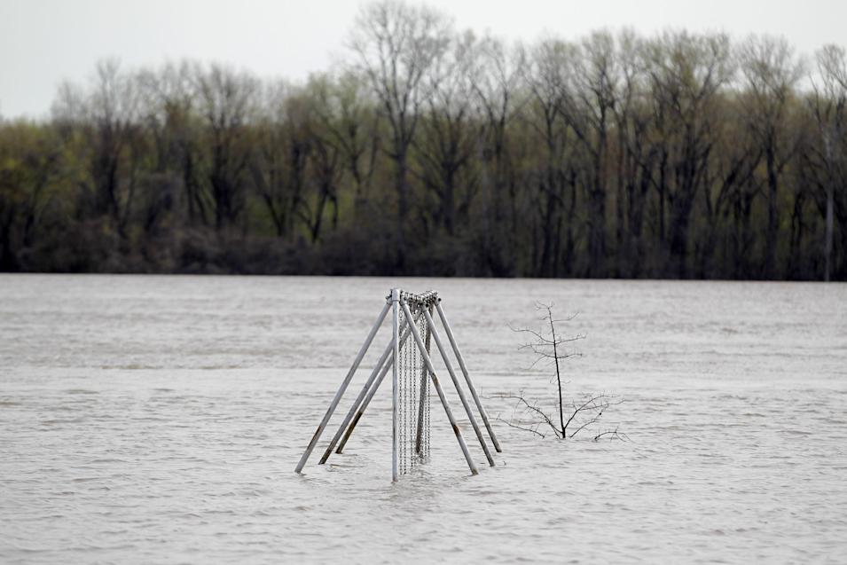 A swing set sits submerged in floodwater from the Mississippi River, Sunday, April 21, 2013, in Clarksville, Mo. Many have come to the aid of the tiny community, working since Wednesday to build a makeshift sandbag levee that seemed to be holding as the crest, expected to be 11 feet above flood stage, approaches. (AP Photo/Jeff Roberson)