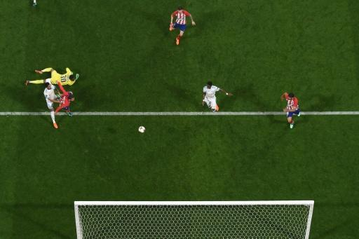 Atletico Madrid's French forward Antoine Griezmann scores the second goal during the UEFA Europa League final against Olympique de Marseille