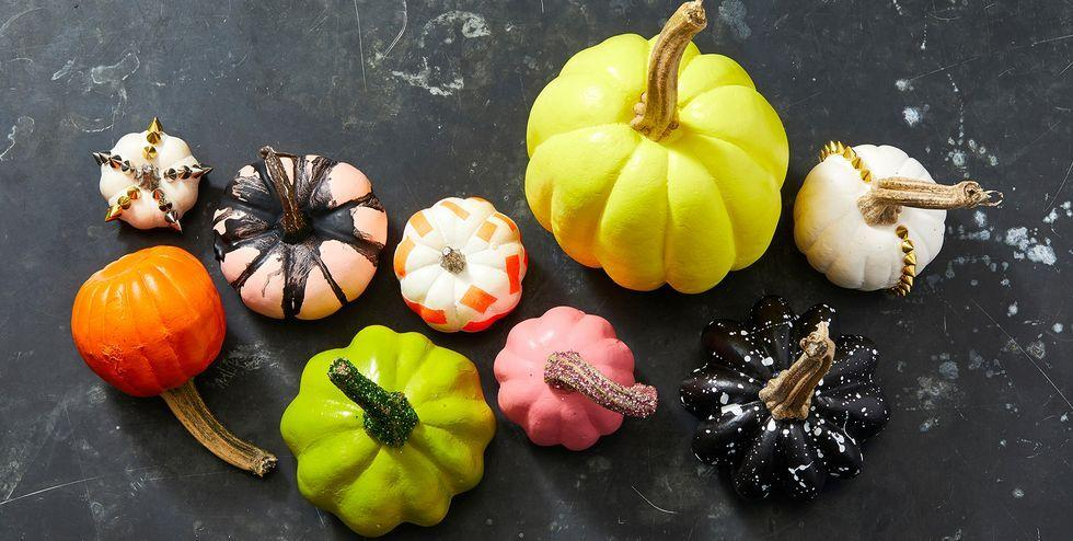 """<p>Pumpkins are the undisputed star of the fall season, and Halloween is really their time to shine.</p><p>When decorating for the holiday, some people choose to <a href=""""https://www.goodhousekeeping.com/holidays/halloween-ideas/g238/pumpkin-carving-ideas/"""" target=""""_blank"""">carve their pumpkins</a> (and if you go that route, be sure to follow these <a href=""""https://www.goodhousekeeping.com/holidays/halloween-ideas/a22196/pumpkin-carving-tips/"""" target=""""_blank"""">expert carving tips</a>). Others choose to avoid the hassle of the carve and go for a <a href=""""https://www.goodhousekeeping.com/holidays/halloween-ideas/g1714/no-carve-pumpkin-decorating/"""" target=""""_blank"""">no-carve pumpkin</a> instead.</p><p>If you're painting pumpkins this year, great. It's a fun activity for the whole family and a chance to show off your creative skills. Plus, your painted pumpkin will last longer than a carved one, so you get to impress the neighborhood with your design all season long!</p><p>Stumped on a design for your perfect pumpkin? There are many paths you could go, whether you want to make it spooky, give it a <a href=""""https://www.goodhousekeeping.com/holidays/halloween-ideas/g23570028/pumpkin-faces/"""" target=""""_blank"""">creepy or gruesome face</a> or perhaps even use your pumpkin as a landscape to paint a whole <a href=""""https://www.goodhousekeeping.com/holidays/halloween-ideas/g29579568/classic-halloween-movies/"""" target=""""_blank"""">Halloween movie</a> scene. From acrylic and spray paints to paper cut-outs to faux flowers, <a href=""""http://www.goodhousekeeping.com/holidays/halloween-ideas/g32984536/glitter-pumpkin-ideas/"""" target=""""_blank"""">glitter</a> and more, there are also a ton of options available to you for designing and decorating your perfect pumpkin.</p><p>If you're stuck for inspiration, we've got you covered. Here you'll find a wide array of painted design ideas for pumpkins, ranging in size, color and shape. While most of these work best on full-size pumpkins, there are several option"""