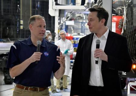 NASA Administrator Jim Bridenstine and SpaceX Chief Engineer Elon Musk talk to the press after a tour of  SpaceX headquarters in Hawthorne
