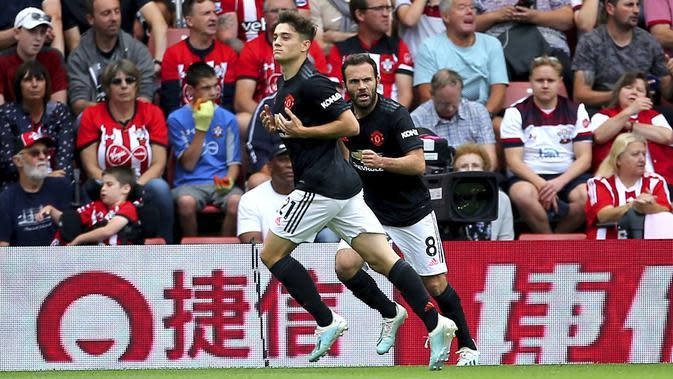 Gelandang Manchester United, Daniel James, merayakan gol yang dicetaknya ke gawang Southampton pada laga Premier League di Stadion St Mary's, Southampton, Sabtu (31/8). Kedua klub bermain imbang 1-1. (AP/Mark Kerton)