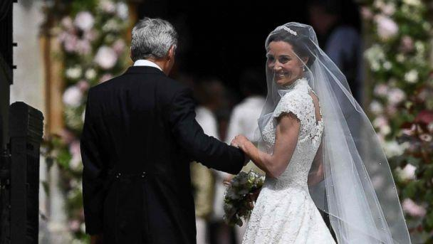 PHOTO: Pippa Middleton is escorted by her father Michael Middleton, as she arrives for her wedding to James Matthews at St Mark's Church in Englefield, west of London, May 20, 2017. (Justin Tallis/AFP/Getty Images)