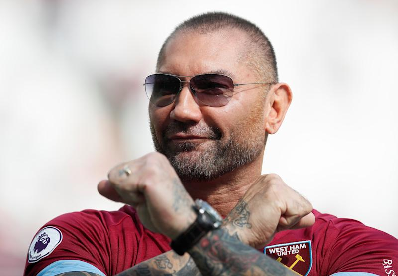 """Soccer Football - Premier League - West Ham United v Wolverhampton Wanderers - London Stadium, London, Britain - September 1, 2018 Dave Bautista gestures before the match REUTERS/David Klein EDITORIAL USE ONLY. No use with unauthorized audio, video, data, fixture lists, club/league logos or """"live"""" services. Online in-match use limited to 75 images, no video emulation. No use in betting, games or single club/league/player publications. Please contact your account representative for further details."""