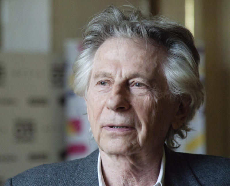 """FILE - In this May 2, 2018 file photo, director Roman Polanski appears at an international film festival, where he promoted his latest film, """"Based on a True Story,"""" in Krakow, Poland. The Paris screening of a new French-Italian film """"An Officer and a Spy"""" is going ahead despite a new allegation that its director Roman Polanski raped a woman decades ago. The screening on Tuesday, Nov. 12, 2019 will be attended by the film's crew. (AP Photo, file)"""